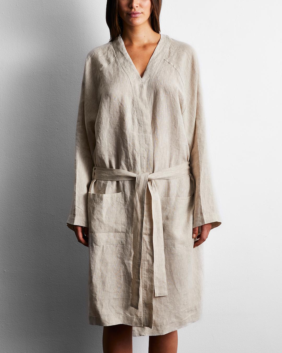 A woman wears a linen oatmeal robe.