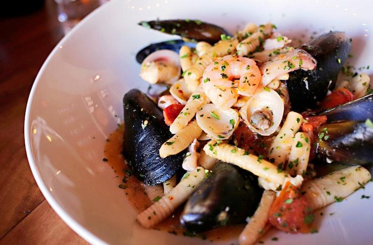 Seafood pasta in white bowl from Perth Italian restaurant La Sosta