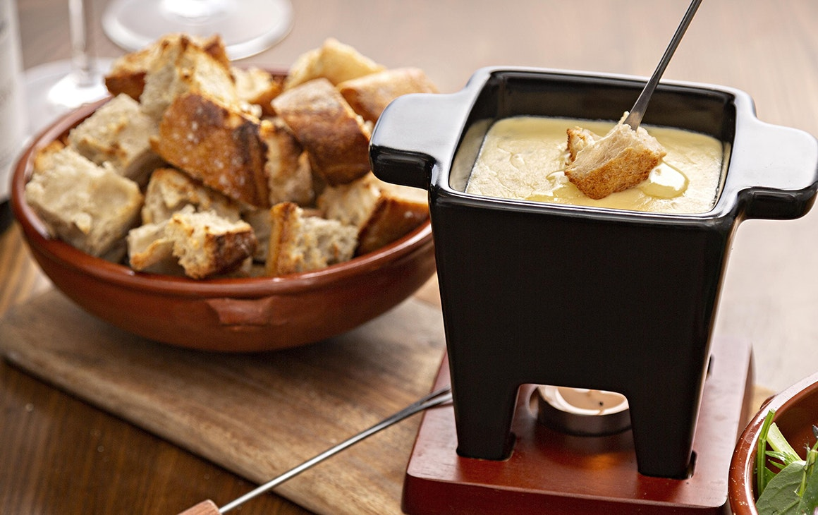 A delicious cheese fondue paired with croutons and salad