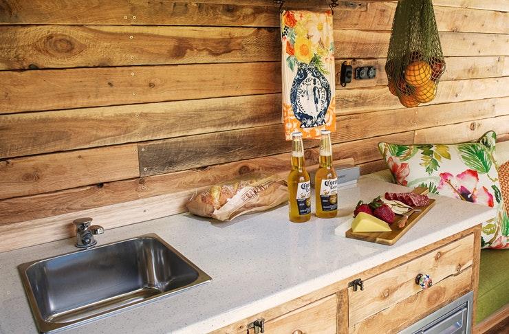 A timber kitchen inside a Cosy Camper camper van in Brisbane.