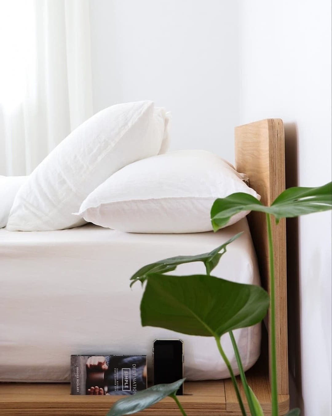 Two plush white pillows rest on a cloud-like bed.