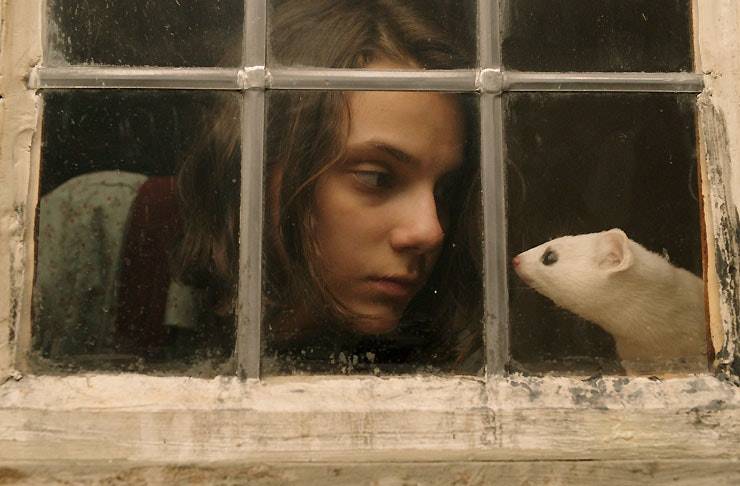 Dafne Keen as Lyra and her Daemon, Pan the mouse in HBO/BBC's His Dark Materials