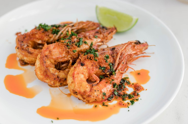 Grilled prawns on a plate.