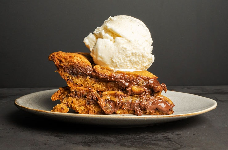 Slices of Messina's decadent cookie pie with a scoop of Messina gelato on top.
