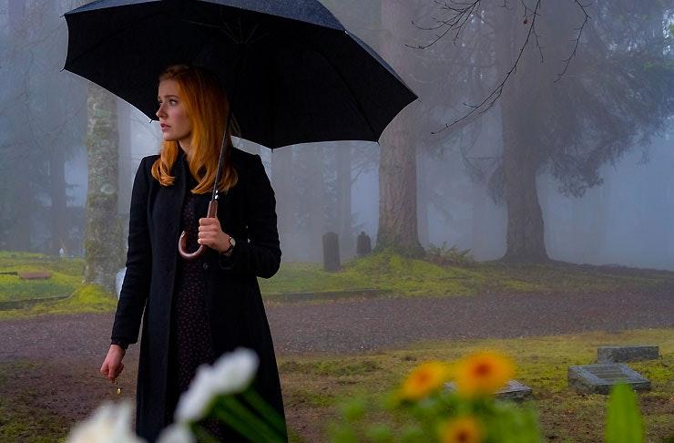 Kennedy McMann as Nancy Drew holding a black umbrella in The Cw's Nancy Drew reboot
