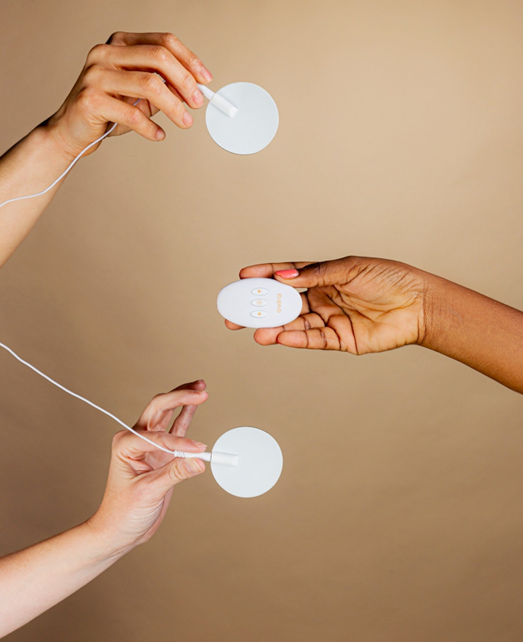 Women hold an Ovira device for period pain.