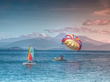 Take To The Sky At One Of New Zealand's Best Parasailing Spots