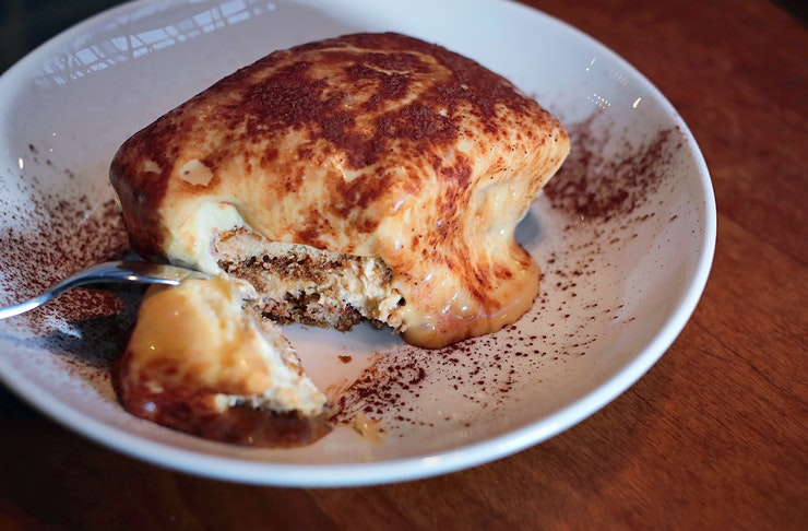 Tiramisu covered with custard and cacao