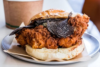 A fried chicken burger topped with truffle shavings