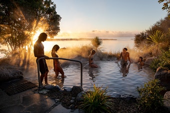 People step into a beautifully steaming spa at the Polynesian Spa in Rotorua.