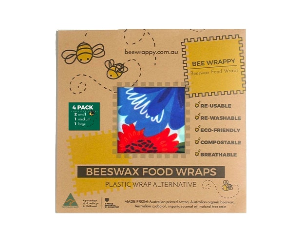 A cardboard box of Beeswax Food Wraps with bees drawn all over the packaging.