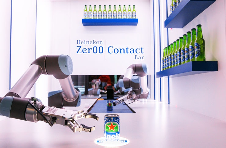Robotic arms serve alcohol free bar at the Heineken Zero Contact Bar in Sydney.