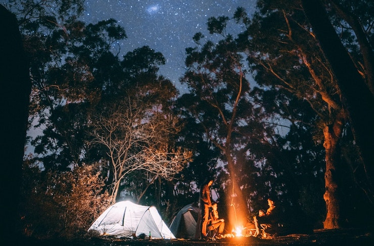 A tent is set up amongst the trees in Dwellingup at night