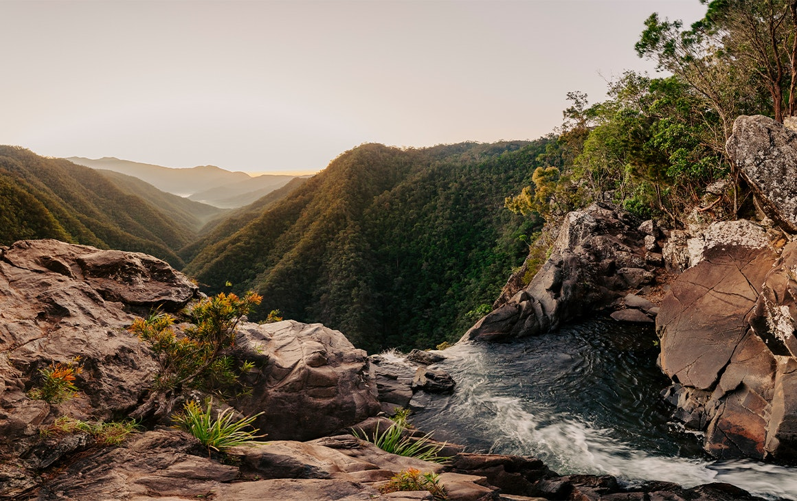 View from the top of a waterfall over mountains
