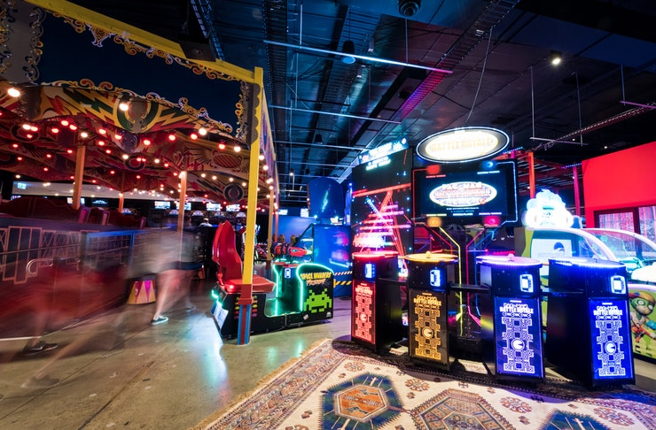 A bright and colourful gaming arcade.
