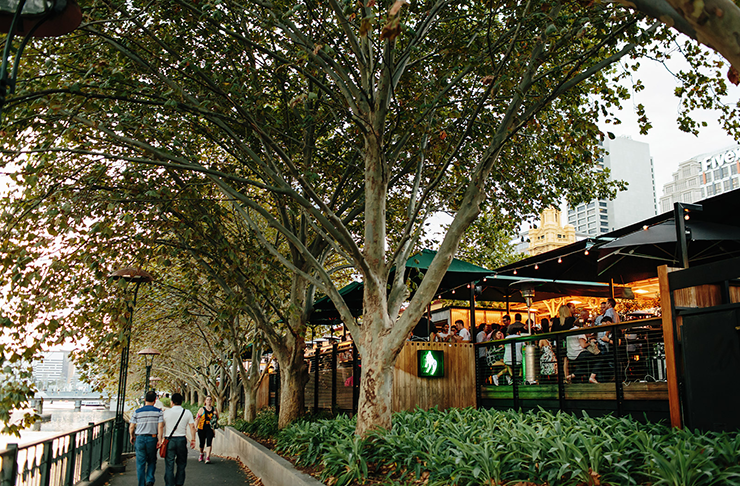 Melbourne's Arbory bar filled with people drinking and socialising by the Yarra River.