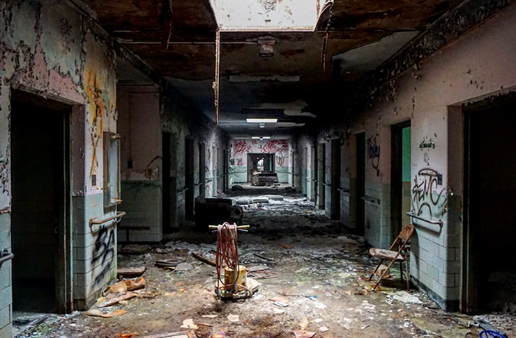 The derelict halls of a disused mental asylum.