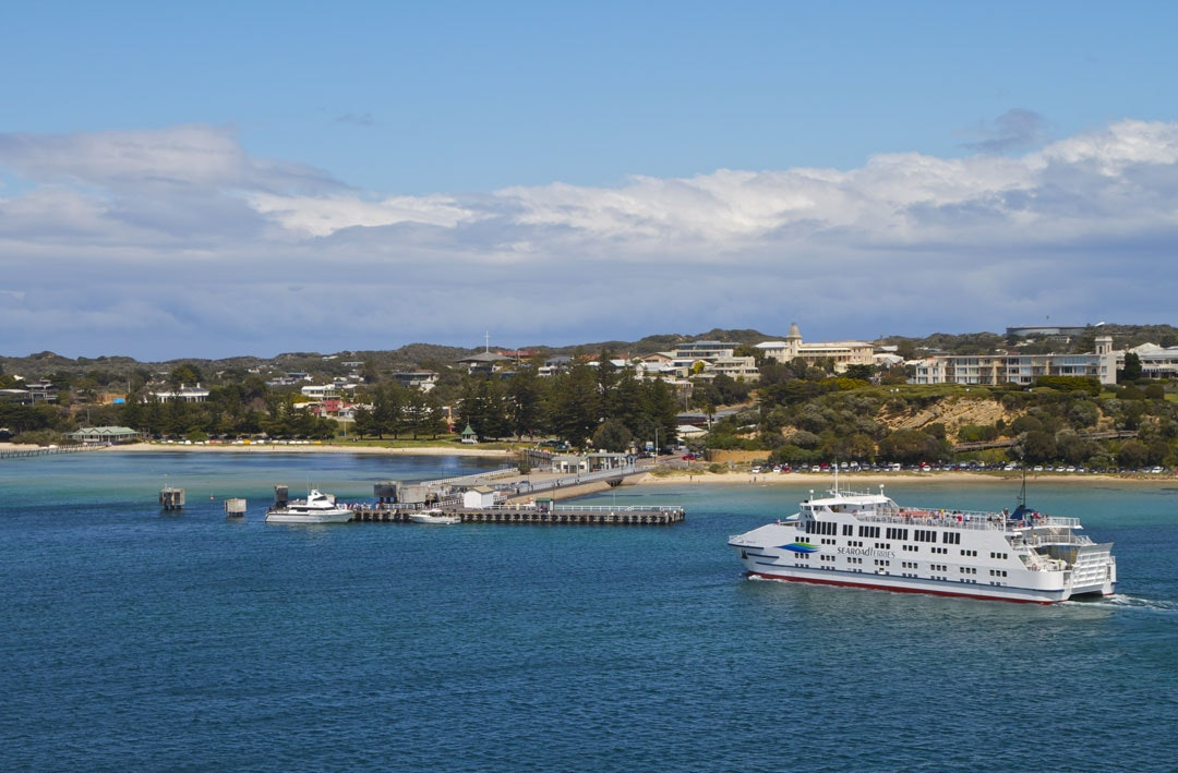 The Searoad Ferry from Sorrento is about to dock in Queenscliff, Victoria. The town can be seen in the background.