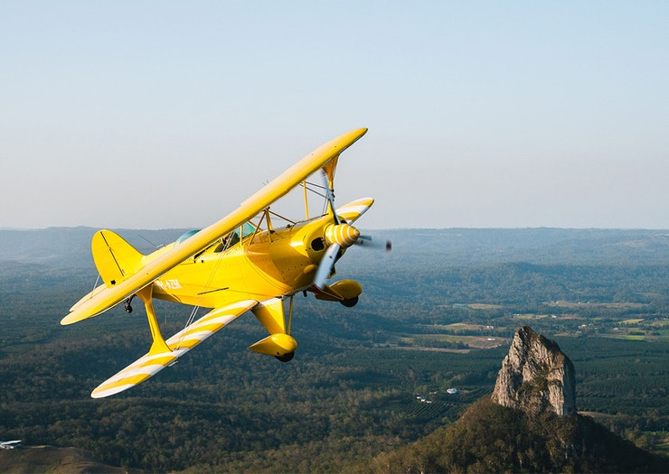 Buckle In For An Adrenaline-Inducing Scenic Flight In These Aerobatic Biplanes