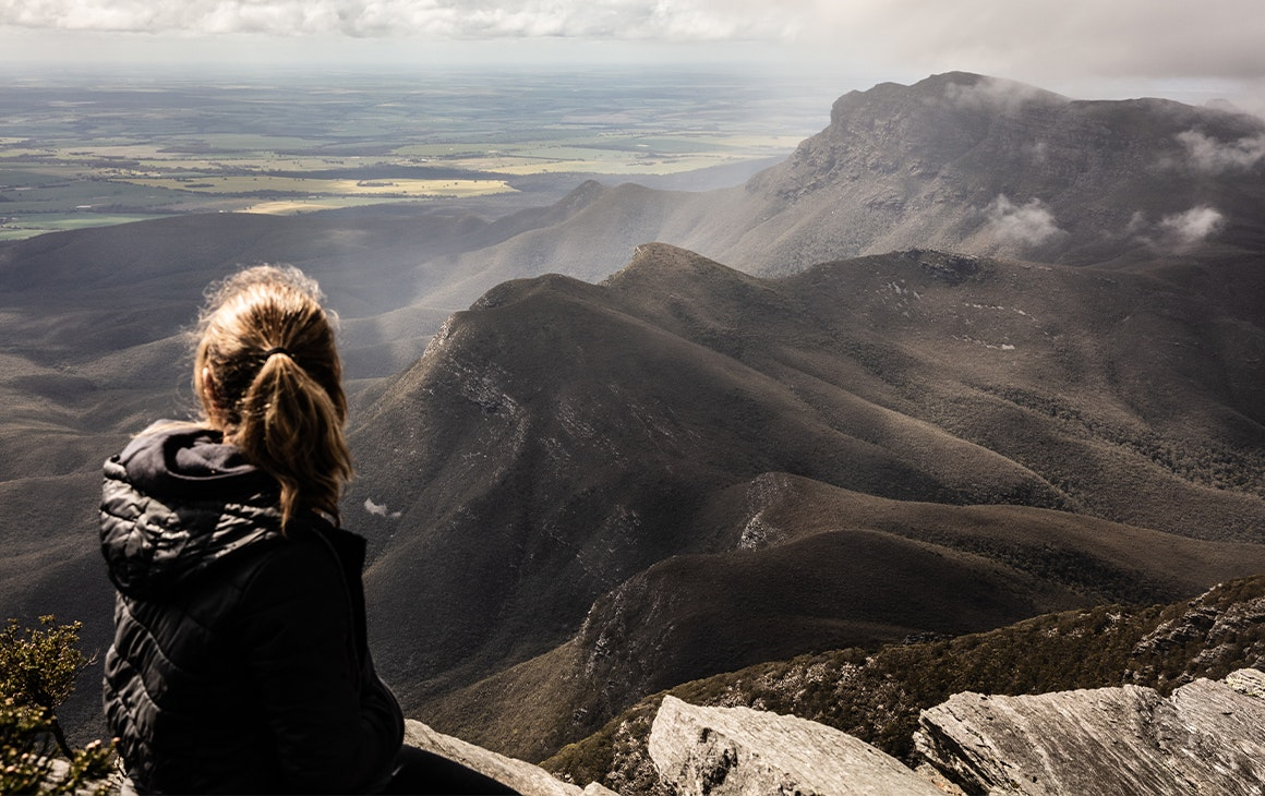 a woman looking out over bluff knoll
