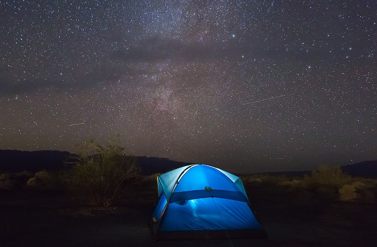 A tent under a sky full of stars