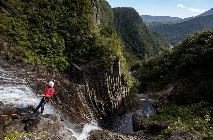 A girl hanging over a deep canyon