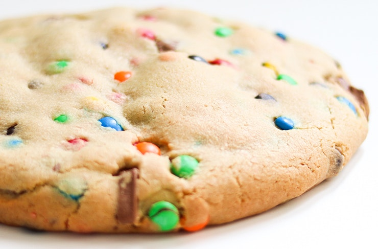 A giant cookie with rainbow sprinkles.