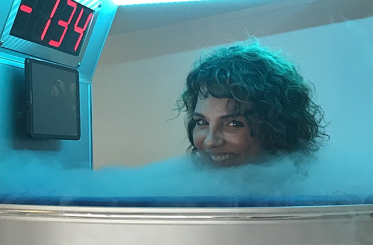 A woman in the cryotherapy pod