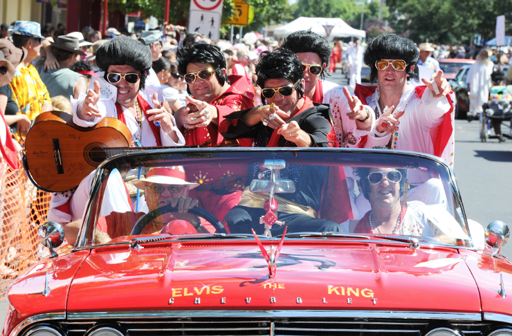 A convertible filled with Elvis impersonators at the Parkes Elvis Festival.