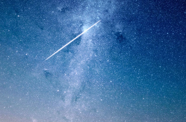 A huge meteor dashed across a starry night sky.