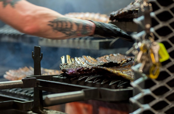 ribs being cooked over grill