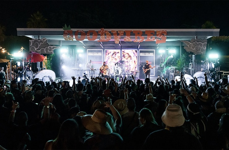 Crowds stand in front of the stage at a Good Vibes gig.
