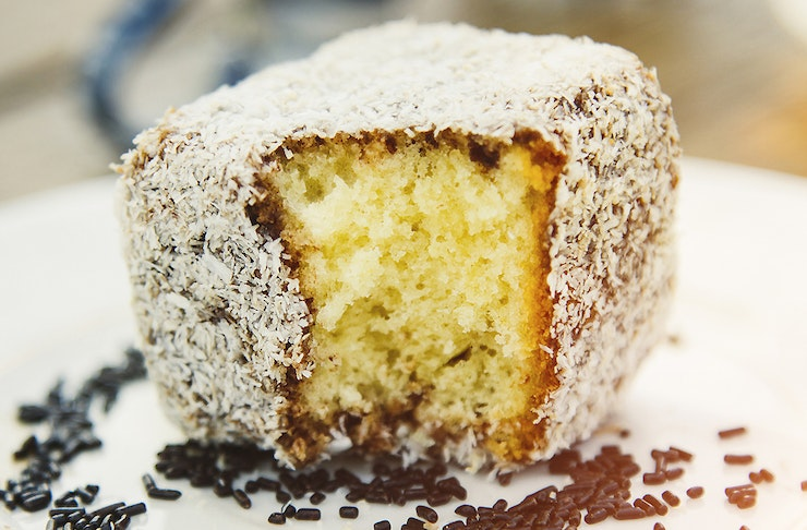 An extreme close up of a Lamington cake.