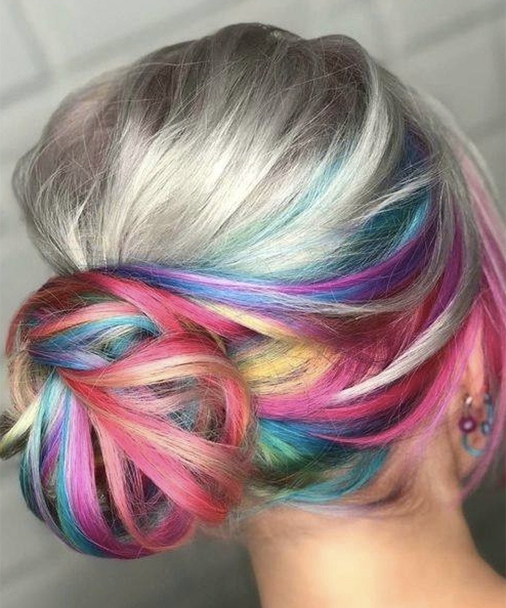 A woman showing off some cool colours in her hair at Live & Let Dye hairdresser in Auckland, one of the best hairdressers in Auckland.