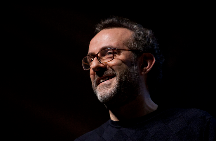 One of the world's most renowned chefs, Massimo Bottura, smiling contently at the camera.