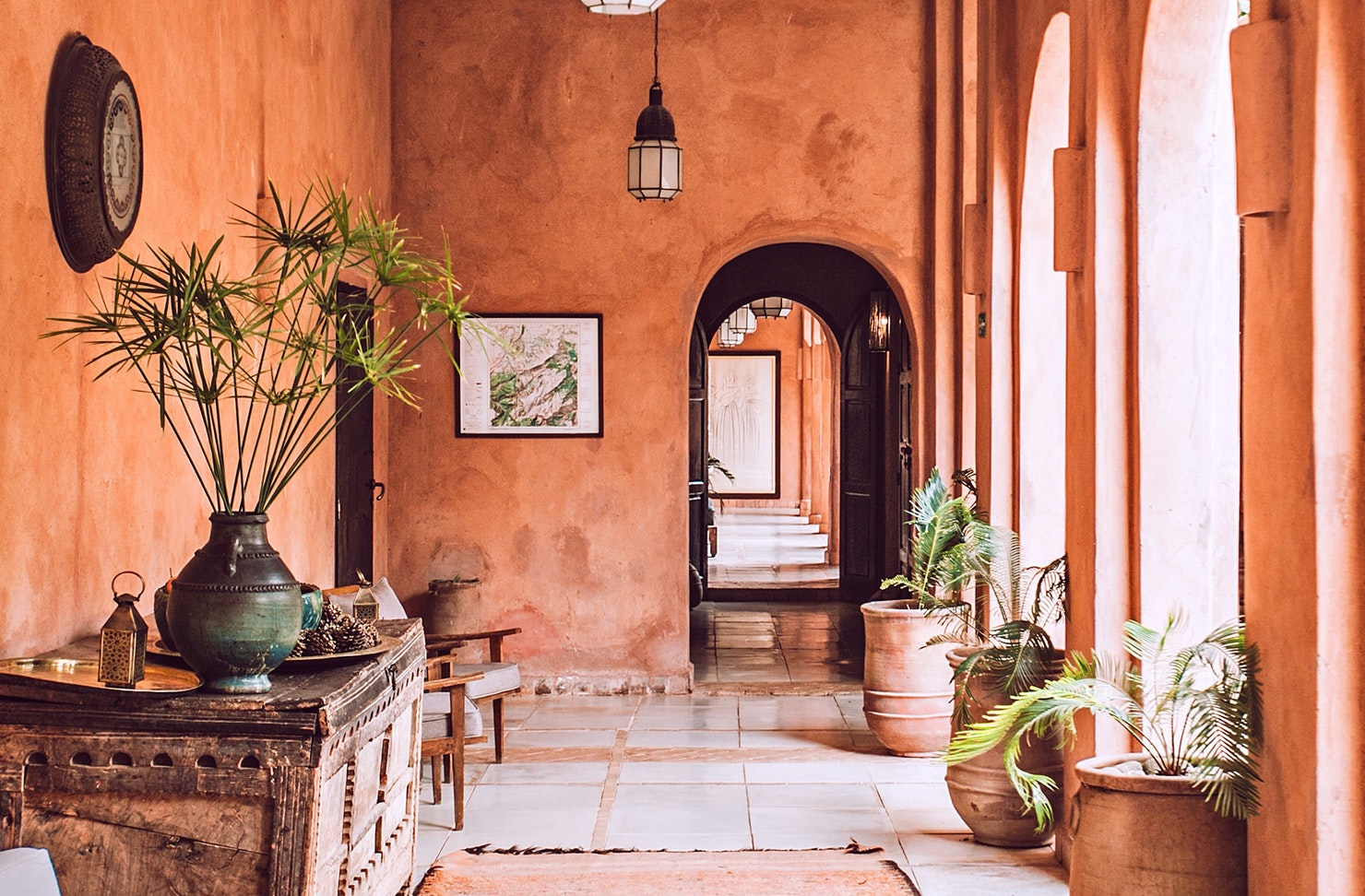 A terracotta-coloured interior of a beautiful building in Morocco.