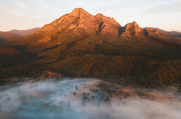 View of Mt Barney at sunrise, soft mist in the foreground
