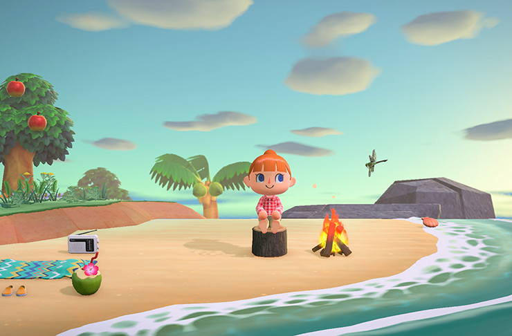 An avatar sitting on the beach in the game Animal Crossing.
