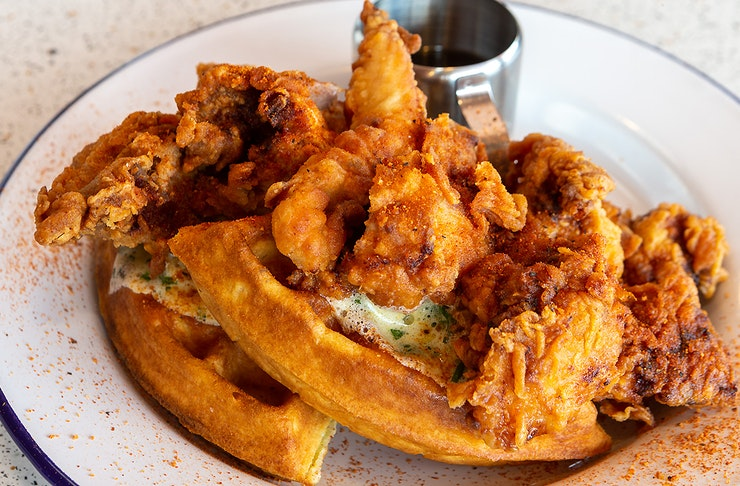 A delicious looking dish of chicken and waffles from Peach's hot chicken, one of Auckland's best American food diners