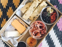 Find A Patch Of Grass, These Local Eateries Are Dishing Up Cheesy Picnic Spreads