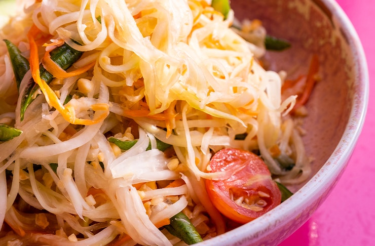 a bowl of papaya salad