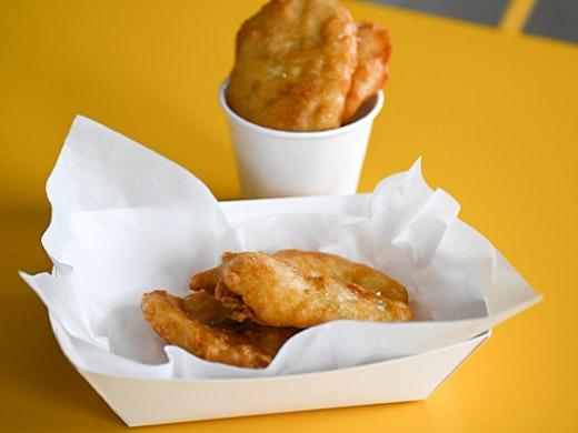 potato scallops in a takeaway box