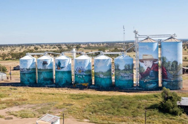 A large artwork on several silos in the queensland outback