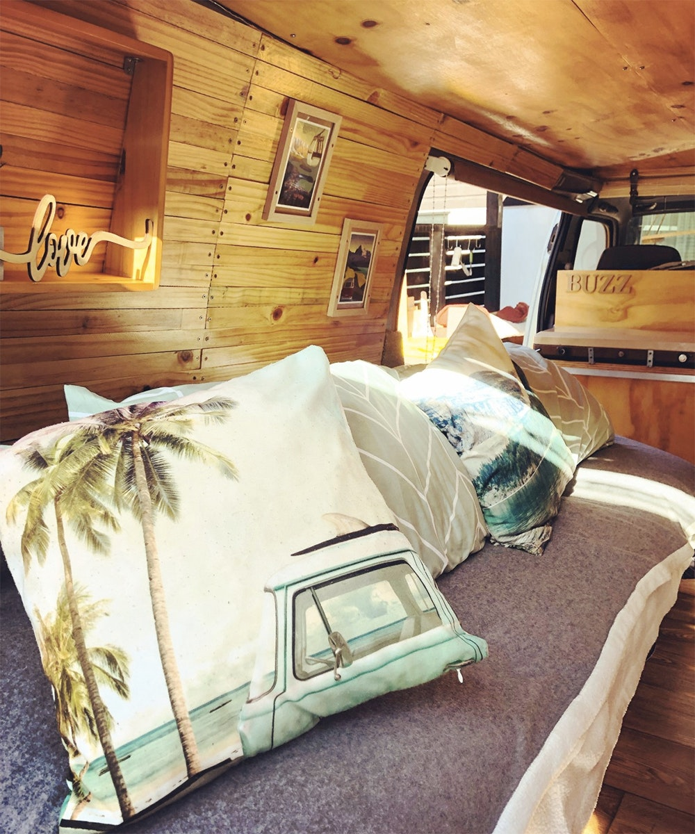 The interior of a campervan called Buzz, one of the boutique campervans you can hire in NZ.