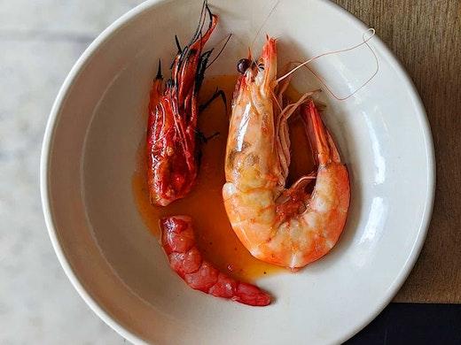 A scarlet prawn dish plated up at Saint Peter restaurant in Paddington, Sydney
