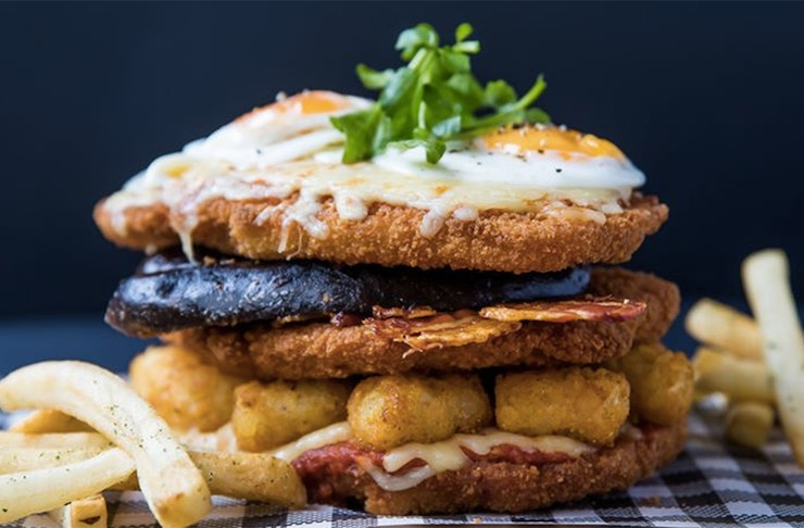 A special st Paddy's day schnitzel on offer at The Bavarian. A three schnitzel stack with blood sausage, eggs and potatoes. One of the best in Auckland