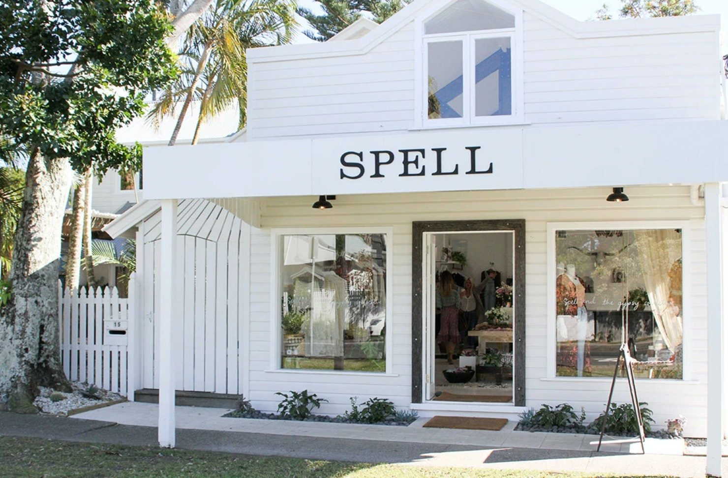 The white exterior of Spell & The Gypsy boutique in Byron Bay.