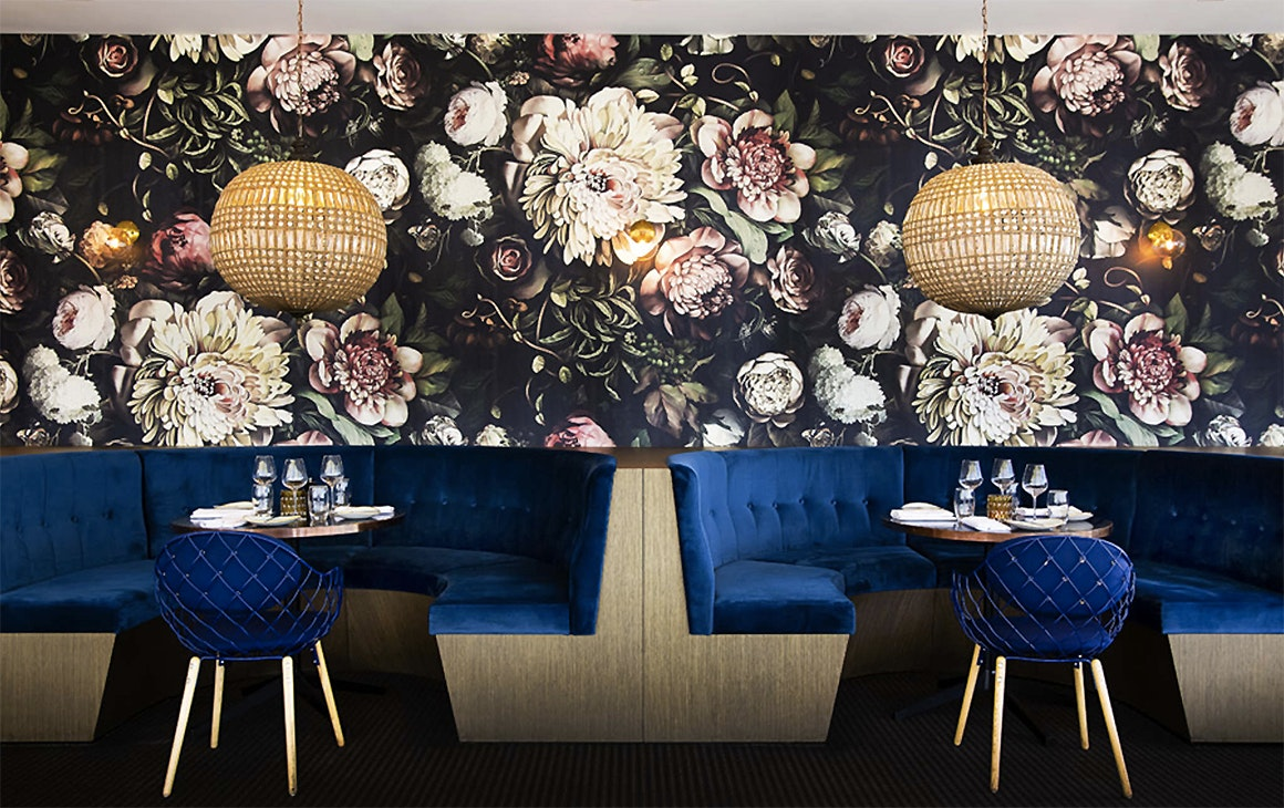 A view of the Vue restaurant showing lush furnishings at the Grand Mercure Auckland.