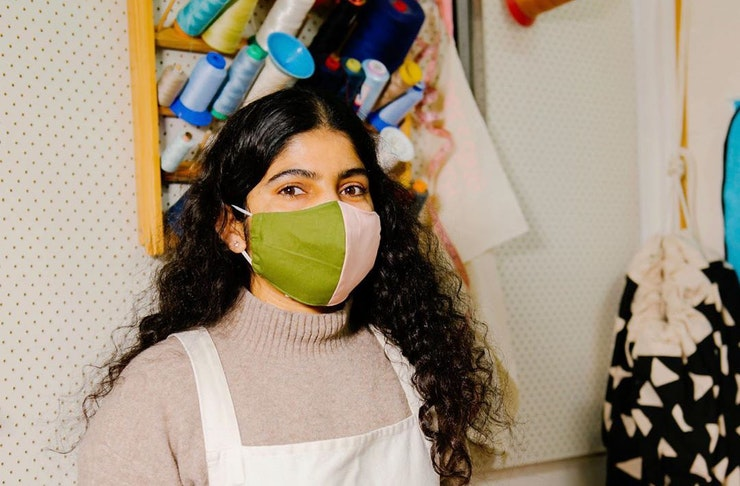 Rohini from Second Stitch models one of their face masks.