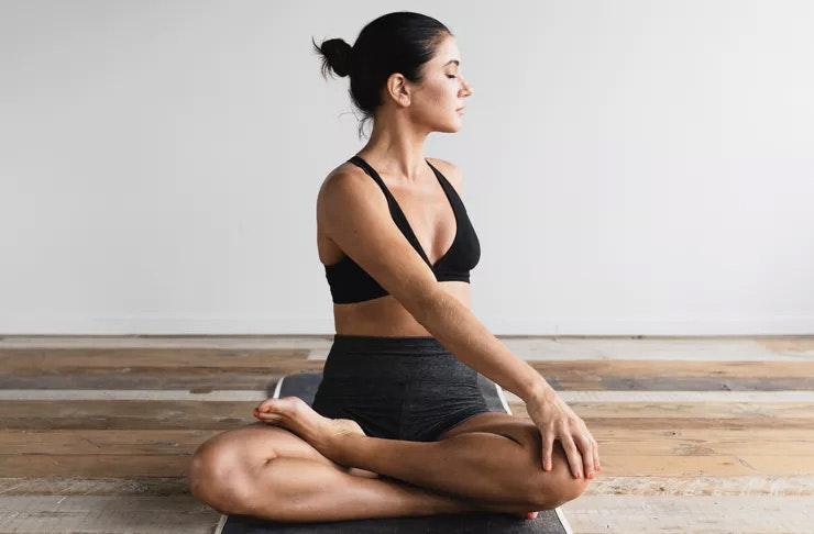 Girl doing a twist, Auckland's best yoga studios